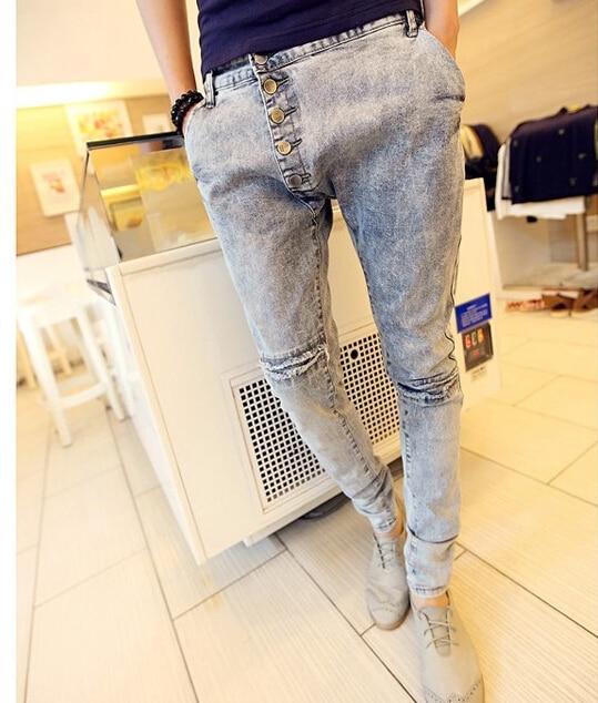2015 Musim Dingin Baru pria Fashon Korea Gaya Slim Skinny Jeans Tombol Terbang Celana Harem Lubang Ripped Kasual Baggy celana
