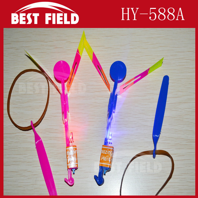 free shipping 50pcs/lot make LOGO red blue flash light Elastic Toy Gift Flash Rotating Flying Arrow Rocket Helicopter LED Light