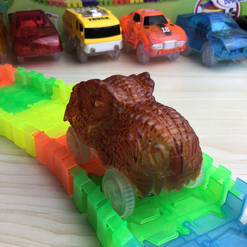 LED Light Up DIY Diecast Electric Dinosaur Car Luminous Track Triceratops Assembled Rail Toys For Children Birthday Party Gift