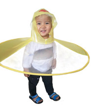 0e6940038f2b1 New children s raincoat children s flying saucer umbrella magical hat free  gloves funny rain cover baby play outdoor products