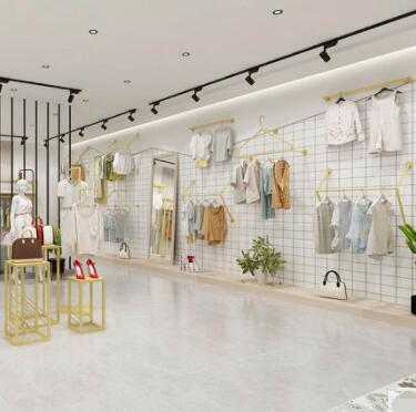 Présentoir de magasin de vêtements sur le mur étagère d'affichage en or pour femmes combinaison de supports suspendus plancher-debout Nakajima