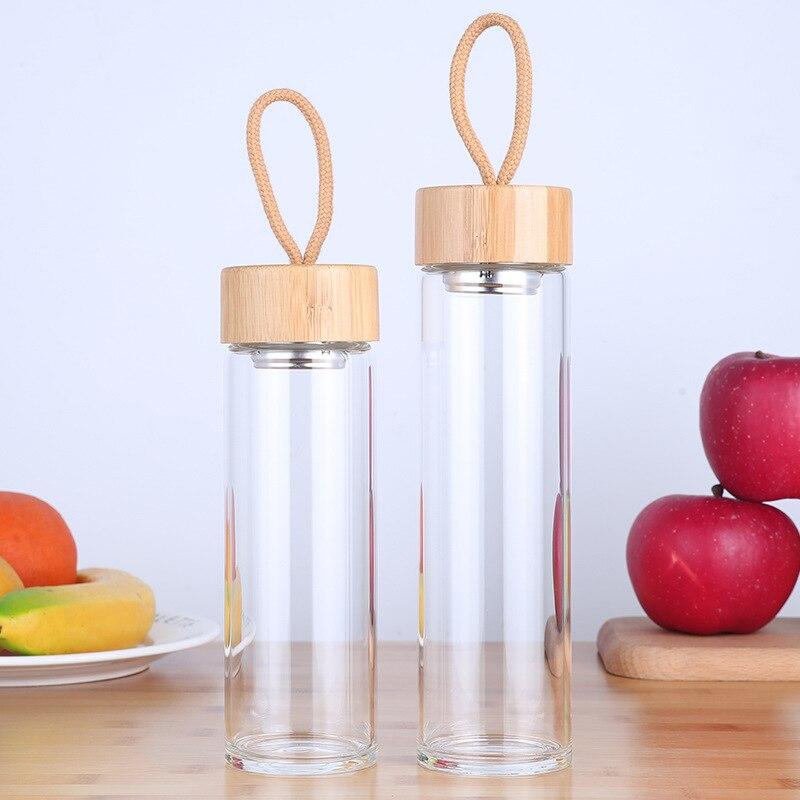 Стеклянная бутылка для питья (380-450 мл) с бамбуковой крышкой и ремешком