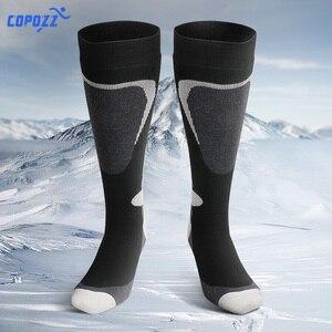 Image 1 - COPOZZ marka kayak çorap kış Snowboard spor çoraplar erkekler & kadınlar kalın sıcak bisiklet çorap nem emme yüksek elastik çorap