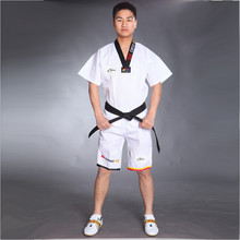 все цены на Wholesale Cotton Breathable Junior Taekwondo Dobok Child Girls and Boys WTF Approve Karate Uniform Suit Training Clothes онлайн