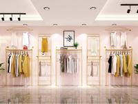衣料品店ラックディスプレイラック、壁掛けダブルデッキぶら下げラック、装飾の女性の衣料品店ラックゴールド