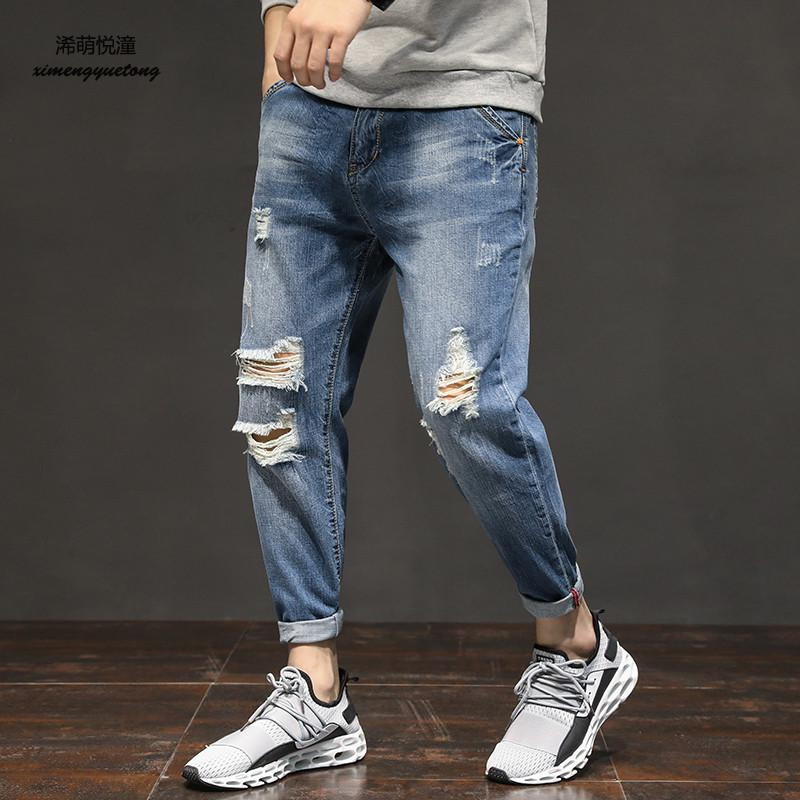 2018 spring and autumn new European and American trend hole jeans mens street casual wild wash water Harlan feet jeans men