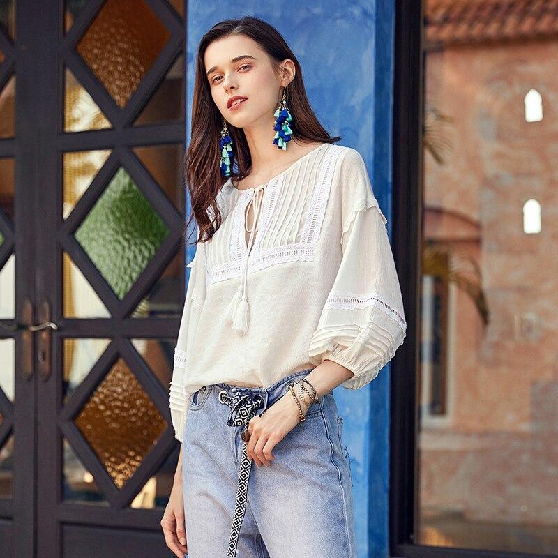 ARTKA 2019 printemps femmes chemise trois quarts couleur unie creux Design décontracté o-cou tout Match Blouse femme vêtements SA10198X