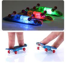 4pcs Mini LED Finger Skate Boards Toys Anti-stress Toys for Adult Kid Children Glow Luminous Fingerboard With Spare Wheels&Tool(China)