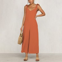 цены Women Casual Summer Solid Color Jumpsuits Lace Up Shoulder Strap Bandage Long Romper Loose Beach Wide Leg Catsuits