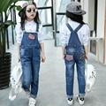 2017 la Primavera y El Otoño Caliente Clásico de La Moda de Los Pantalones del Babero Niñas 4-11-year-old estrella rayada pocket jeans niños del p