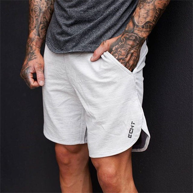 5f9b989d1c015 2017 Verão mens shorts novos Corredores de Bezerro-Comprimento moda Casual  academias de Fitness Musculação