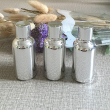hot sale 100pcs silver 30ml glass bottle with screw cap , wholesale high grade sliver 30ml points bottling bottles for essential