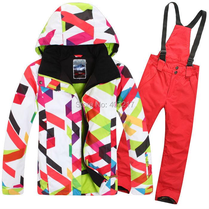 Prix pour 2015 chaude femmes rouge combinaison de ski féminin planche à roulettes costume vêtements de ski coloré courbes veste et rouge roseo pantalon étanche de sport