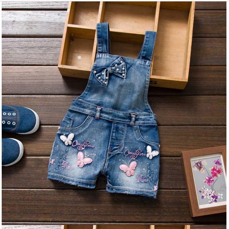 2018 Jauni meiteņu džinsi kombinezoni vasaras bērnu kovboju siksnas šortiņi korejiešu džinsa Jumpsuit bērni cieti kopumā m12580