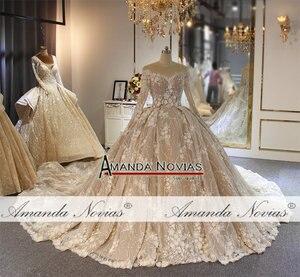 Image 4 - فستان زفاف بلون الشمبانيا مع قطار طويل فاخر وزهور ثلاثية الأبعاد