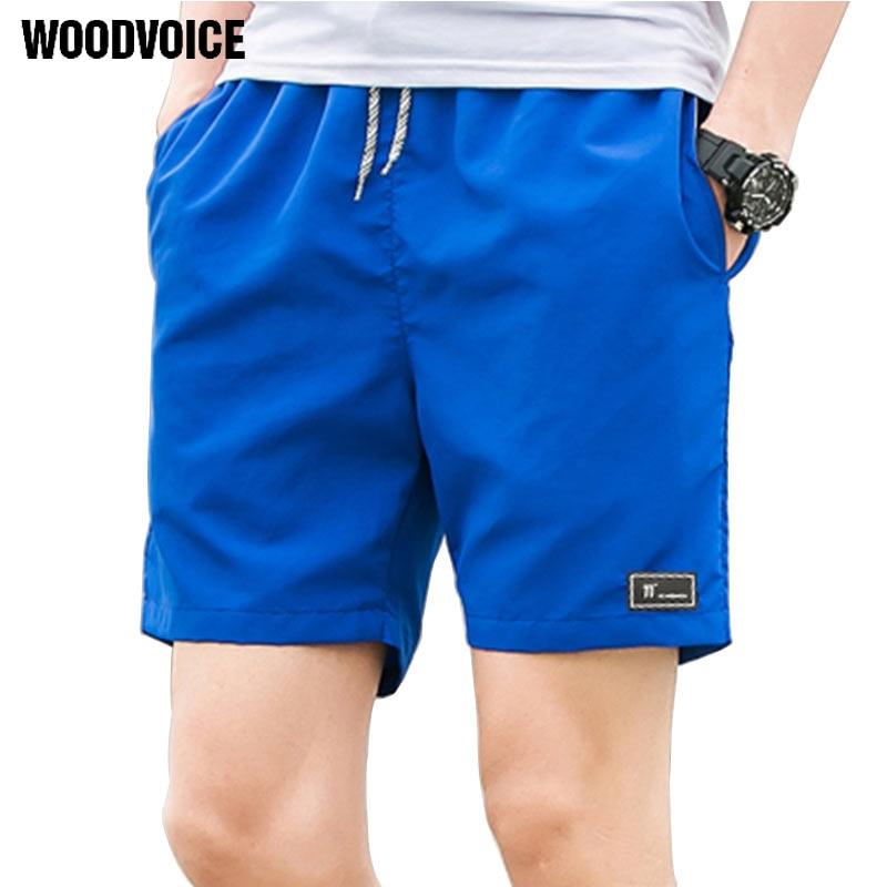 2018 Shorts Occasionnels Hommes Respirant Shorts Mâle Élastique Taille Shorts De Plage Hommes Genou Longueur Rapide Séchage Jogger Conseil Shorts Homme