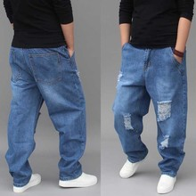 Модные джинсы мужские повседневные Хип Хоп рваные, потертые джинсы с низкой промежностью Свободные мешковатые хлопковые брюки мужская одежда