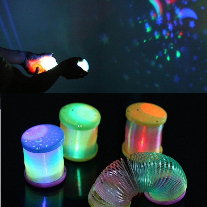 1pcs Random Magic Electric Slinky Rainbow Spring Sleeping Projection Child Funny Classic E