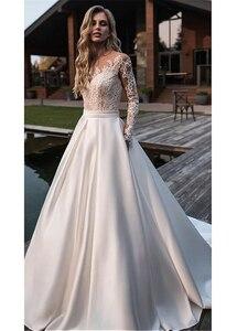 Image 2 - Brilliant Matte Satin Jewel Neckline Bridal Gowns A line Long Sleeves Wedding Dresses With Lace Appliques & Belt & Pockets
