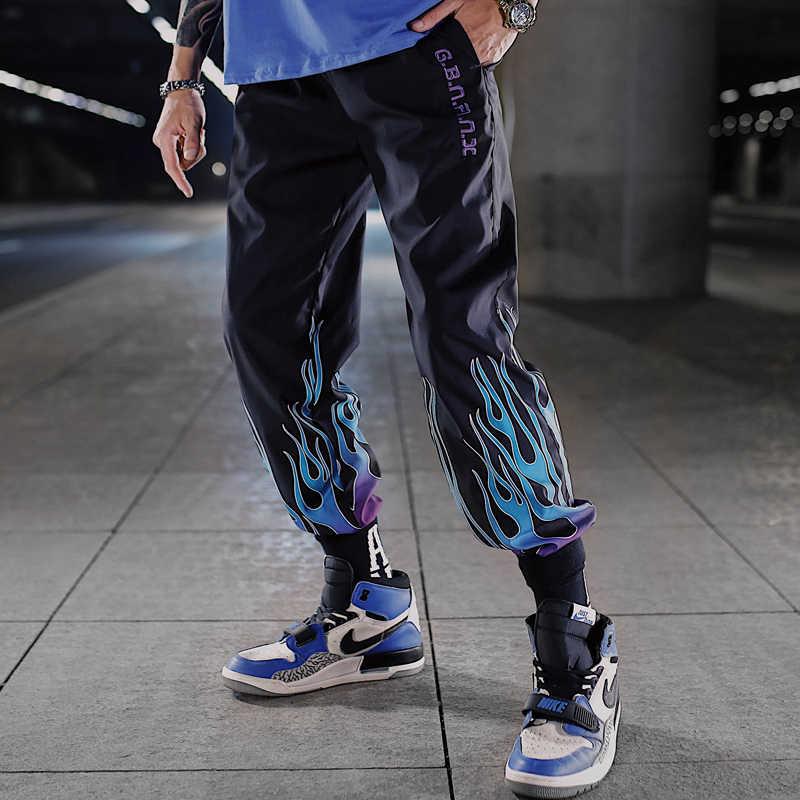 Yangın baskı renk blok Patchwork harem pantolon erkekler Hip Hop rahat Joggers pantolon erkek moda rüzgarlık Joggers Sweatpants