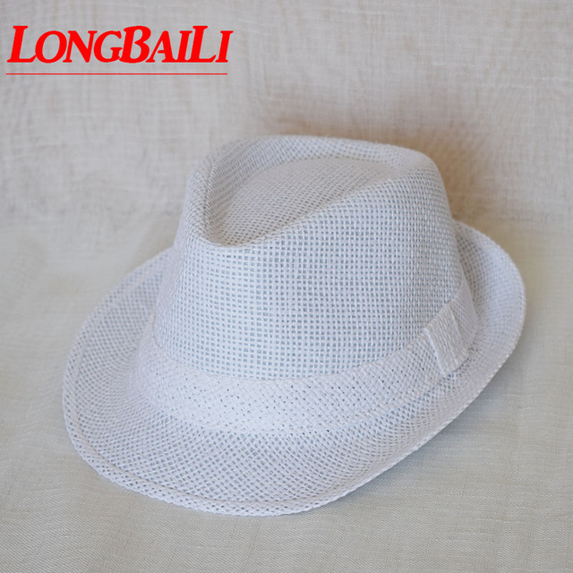 18aa4eadbea 56cm Kids White Straw Fedora Hats For Children Boys Summer Jazz Hats Baby  Top Hat 10pcs lot Free Shipping GPXS014