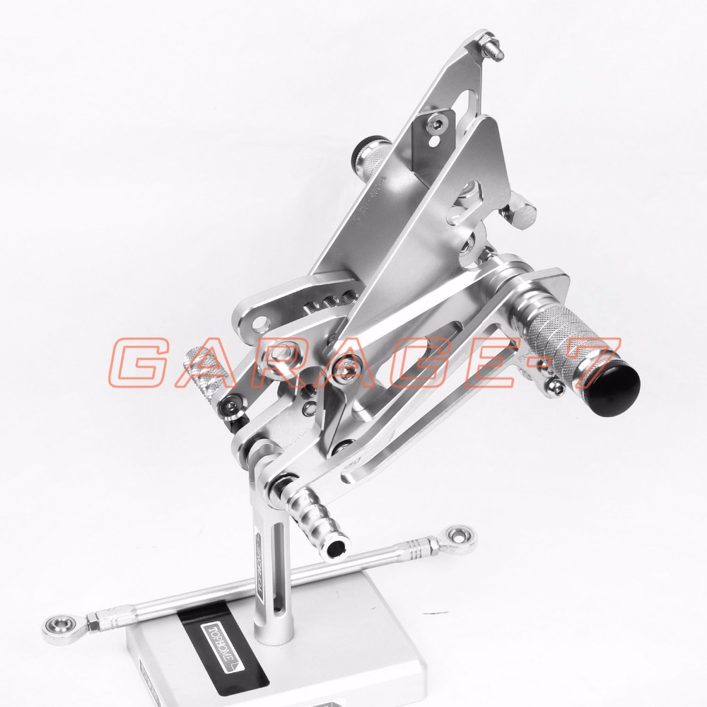 one pair of high-quality Motorcycle  CNC Rearsets Adjustable Rear set Foot pegs For Honda NC30 RVF400 NC35 all years Silver