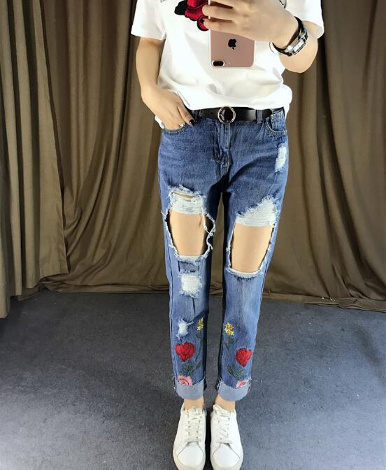 2017 summer new women Korean version of the nine pants rose embroidery hole straight jeans women