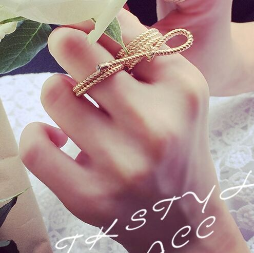 Европа и соединенные Штаты новый полый лук двойной палец кольцо спираль моды все матч женского украшения M2150