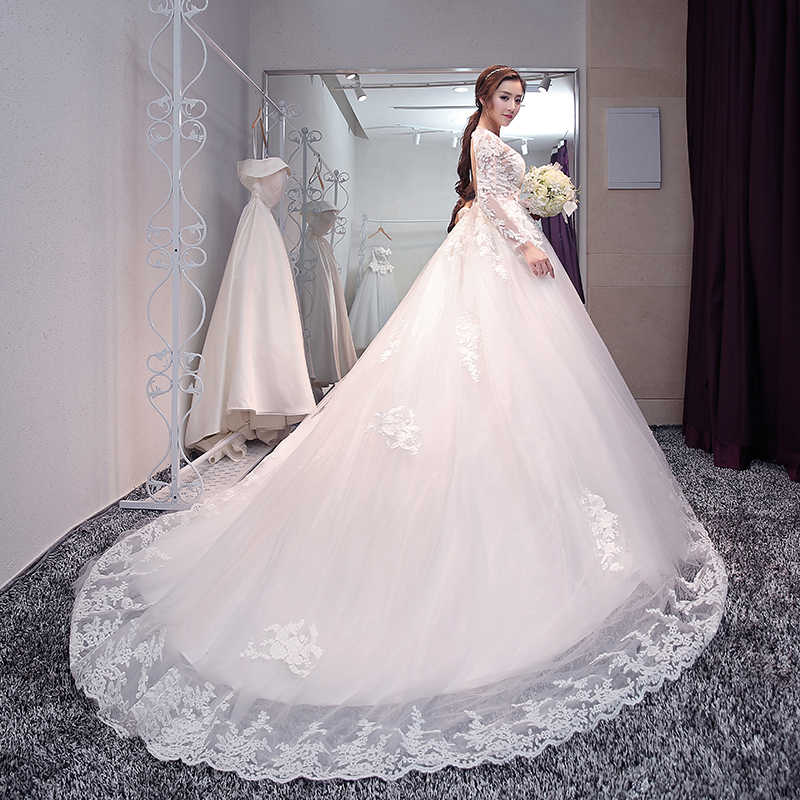 e82a56aabe80 Sexy Backless illusion Full Long Sleeve Embroidery Lace Long Train Wedding  Dress 2017 New Arrival Elegant