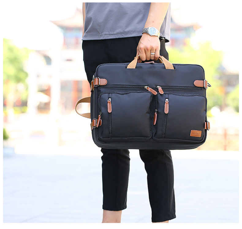 a guy holding a laptop bag on the street