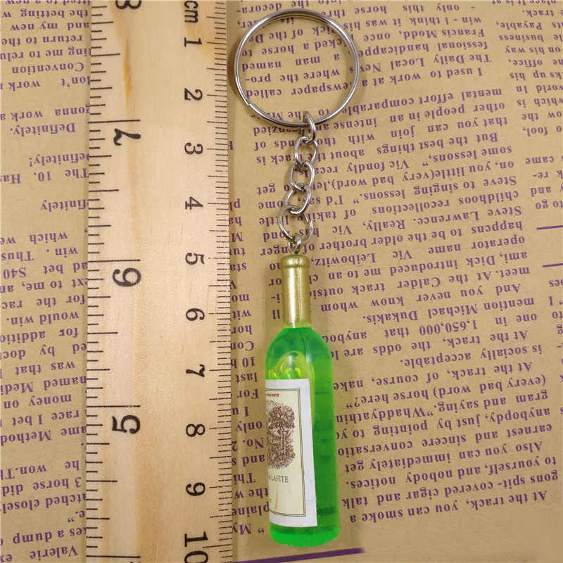 Venda quente 1 pc garrafa pingente cor aleatória mulheres unisex moda promocional móvel chaveiro