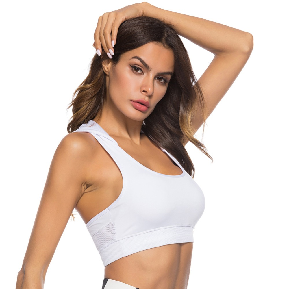 Foto Sport's Bra Top with Push Up for women. Women's Push up top for sport the white color.
