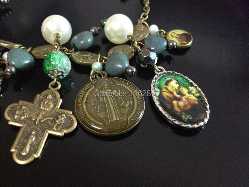 d1a966b0ead 1 scapular cross 23mm*29mm 1 St.Benedict medals with cabochon surface  diameter 23mm 1 St.Anthony and baby Jesus medal 17mm*25mm 2 Mini charms( medals in ...