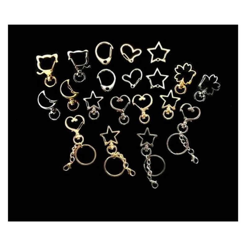 10 piezas DIY dijes gato corazón llavero suspensión estrella Luna alas resina joyería colgante accesorios hecho a mano broche de langosta