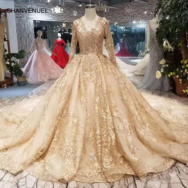 LSS219 golden lace wedding dresses 2019 champagne v-neck long sleeves lace  up back wedding party dress with shiny royal train 59bbc14ccfa2