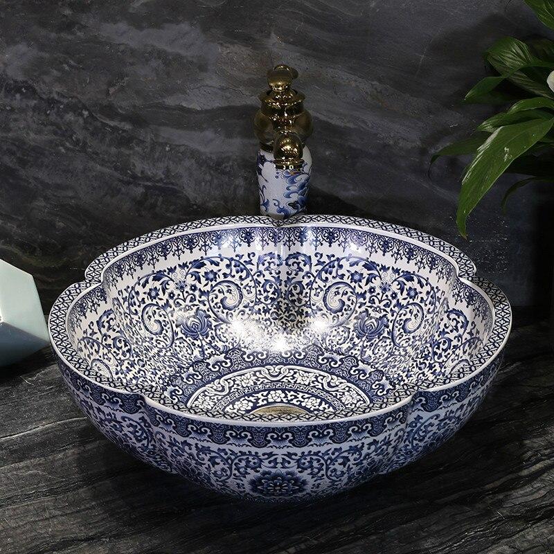 Chinois bleu et blanc porcelaine au-dessus du comptoir bassin en céramique salle de bains éviers fleur pétale art rond lavabo mx01161041