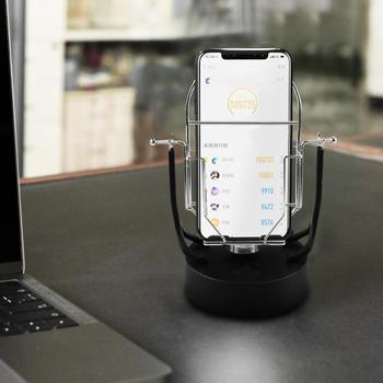 Creativo Columpio Automático Shake Teléfono Wigggler Para WeChat Movimiento Número De Pasos De Cepillo Conjunto De Estantes Decorativos Para El Hogar