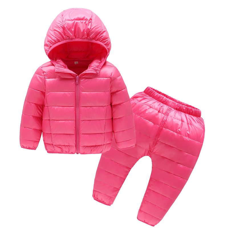 купить Children's suit 2018 new style winter boy girl solid color warm down cotton suit children's two-piece по цене 2493.47 рублей