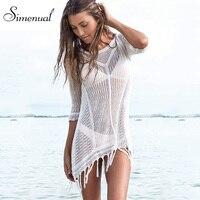 Gland sexy chaude tricoté robe d'été maillots de bain 2016 solid slim blanc plage sortie mini robes dames fringe évider paréos
