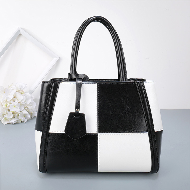 Designer handbags 2018 new ladies bag Europe and the United States fight color shoulder portable leather female fashion handbags new europe and the united states fashion oil wax head layer of leather portable retro shoulder bag heart shaped color embossed h