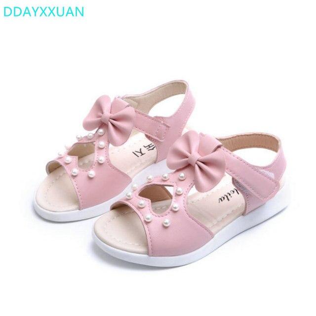 42f11809b1b6e Filles sandales chaussures 2018 nouvelle marque été Bowknot plat enfants  princesse chaussures coeurs enfants plage sandales