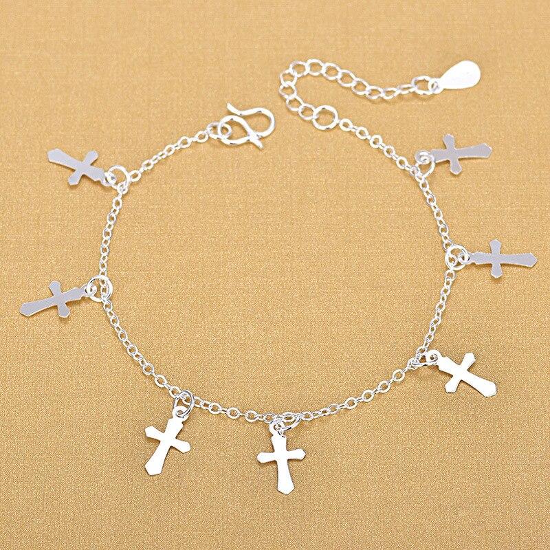 Купить женский браслет из серебра 925 пробы с подвеской крестом