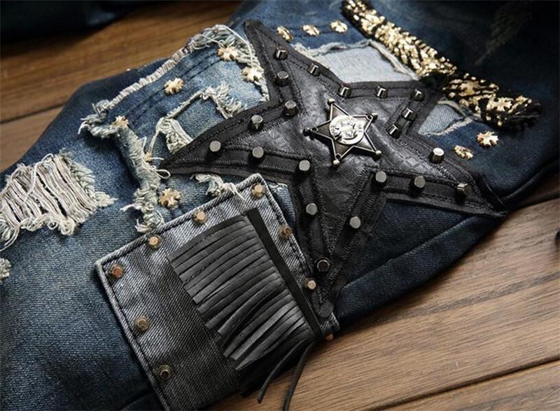 Mustade paikadega teksapüksid