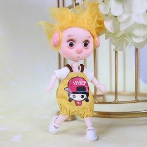 Image 3 - DBS 1/12 BJD 26 joint body cute pig ob11 doll con vestiti scarpe regalo per bambini 15cm mini doll nome di DODO