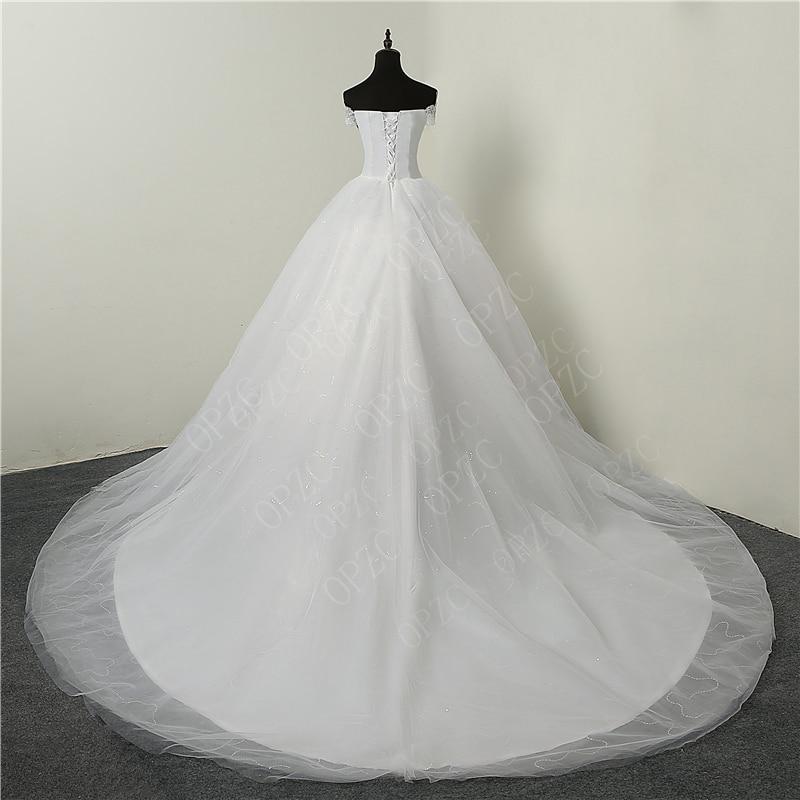 Image 2 - 35% Hot Sale Fashion Simple Lace Tull 2019 Wedding Dresses 100cm Long Train Boat Neck Elegant Plus size Vestido De Noiva Bride-in Wedding Dresses from Weddings & Events