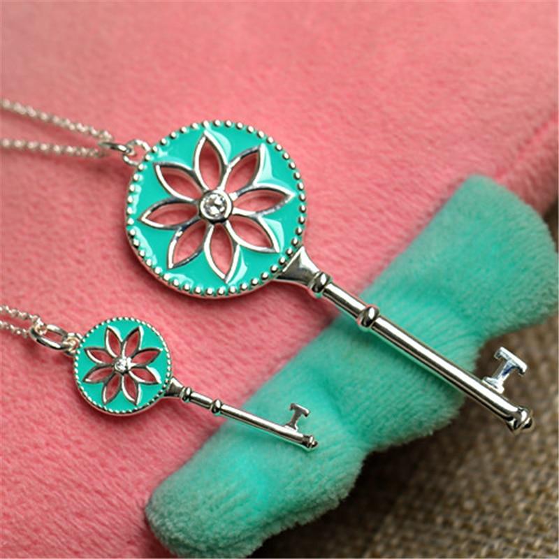 Émail bleu Daisy clé pendentif collier femmes 100% pur argent Sterling 925 avec pierre chaude marque élégante douce clé collier cadeaux