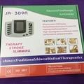 JR-309 Estimulador Eléctrico Full Body Relax Masajeador Muscular Pulso Decenas Acupuntura Terapia Slipper + 6 Almohadillas de Electrodos