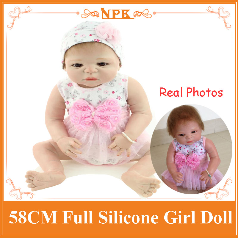 Full Silicone Vinyl Reborn Baby Doll Dressed In Cute Short Skirt With Pink Bow Adora Bonecas As Children Toys At Christmas Days cute elephant style baby polyester music box doll blue orange pink