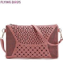Pěkná dámská kabelka přes rameno růžové barvy s dírkami