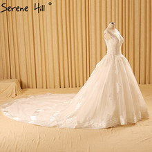 White Princess Ball Gown Sexy Wedding Dresses 2017 Robe De Mariee Fashion Simple Sleeveless Tulle Bridal Dresses